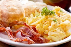 Scrambled eggs, bacon, and biscuits for breakfast.