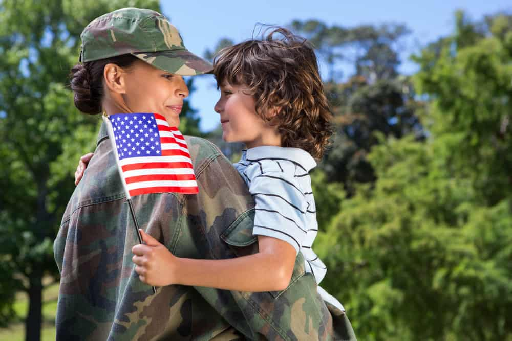 military mom holding son
